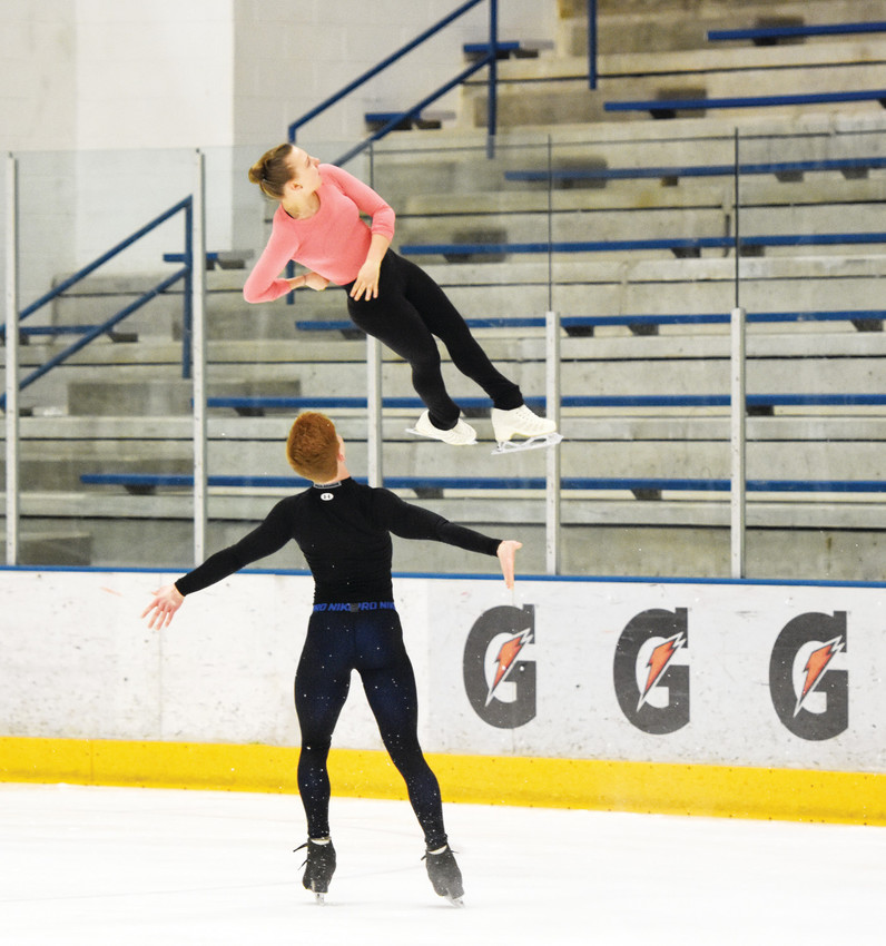 Figure skaters Blake Eisenach and Eliana Secunda work on an intricate airborne maneuver. right, and the 'death spiral,' above, at the Promenade Ice Centre in Westminster.