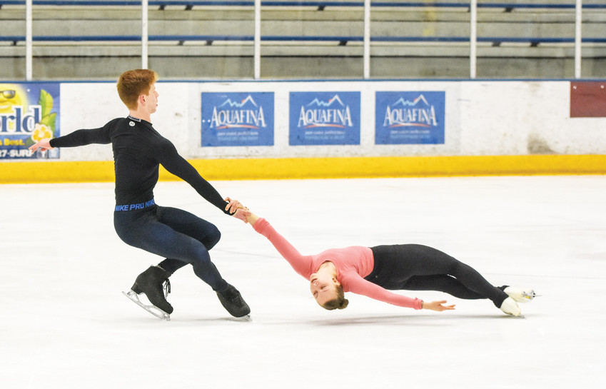 "Figure skaters Blake Eisenach, left, and Eliana Secunda, practice a ""death spiral"" at the Westminster Promenade Ice Centre, Friday Nov. 10, 2017."