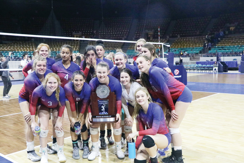 Cherry Creek players pose with the trophy they won when they finished second at the Class 5A state volleyball championships. The Bruins defeated three higher-seeded teams to get to the finals, where they lost the deciding fifth set to Castle View.