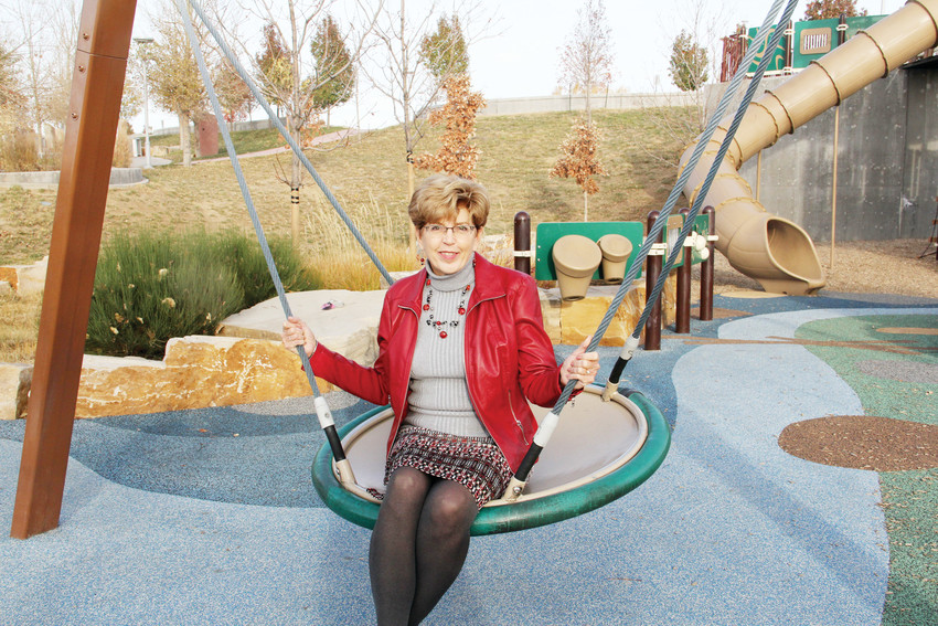 Mayor Cathy Noon sits on a swing at Centennial Center Park Oct. 31. The park, which sits just behind Civic Center, opened in 2012 during Noon's tenure.