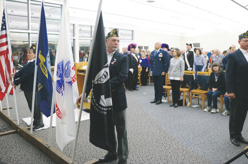 Highlands Ranch American Legion Post 1260 and Pax Christi Assembly 3353 Knights of Columbus lead the retiring of colors ceremony at a Veterans Day celebration on Nov. 11 at James H. LaRue, 9292 S Ridgeline Blvd.