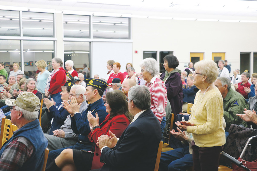 Guests of the Veterans Day Celebration at James H. LaRue, 9292 S Ridgeline Blvd., applaud family members of the men and women who have served. The evening included speakers, a poster contest, music, presentation of colors, treats from Kneaders Bakery and Cafe in Highlands Ranch and more.