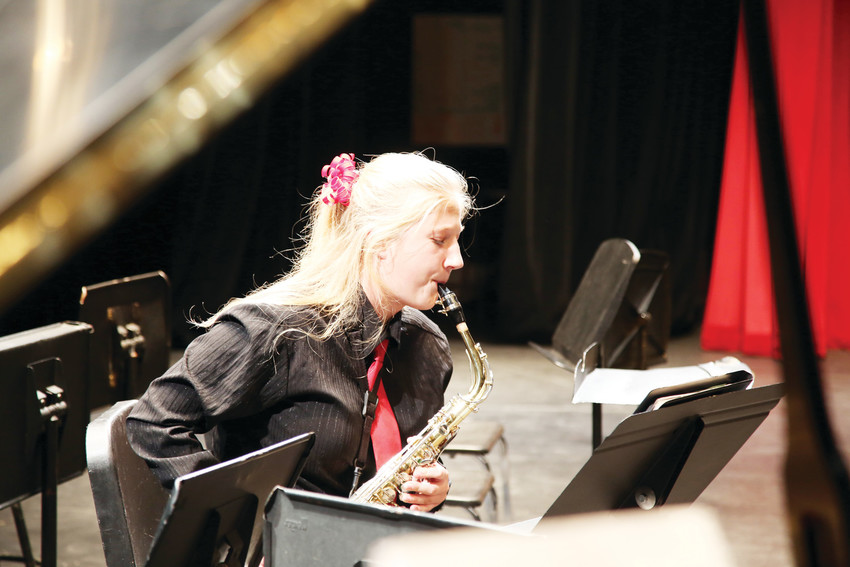 Ciana Vrtikapa, 17, warms up before playing saxophone in the Pomona High Jazz band Monday, Nov. 6.