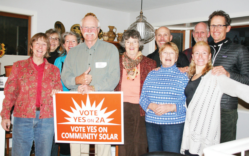 Supporters of Golden's solar ballot issue celebrate during a watch party on Nov. 7 at a private residence. Jim Dale, who ran unopposed for Ward 3 is in front, holding the sign. As of 10:24 on election night, the ballot issue passed among Golden voters with 81 percent support.