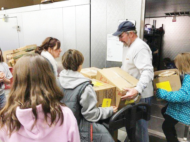 Volunteers at the Parker Task Force food bank came together to help provide Thanksgiving meals for nearly 200 families in Parker last year. Photo courtesy of Parker Task Force