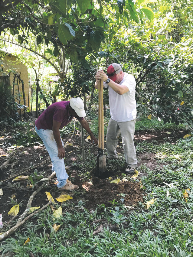 Lanny York, left, uses a post hole digger as one of the Honduran helpers checks the depth of the hole as the two men work together to build a coop for Project Poultry. York, a Parker businessman, founded Operation Hand Up International to help poor families living in the mountains of Honduras improve their lifestyle. Project Poultry is aimed at helping families establish sizable chicken flocks as a basis for chicken and egg businesses. PHOTOS COURTESY OF LANNY YORK
