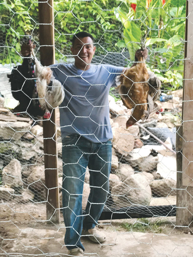 Pedro Sortososa, foreman of Project Poultry, holds up two of the 10 hens that will be provided to help establish a large brood of chickens for a poor family in the mountains of Honduras. The aim of Project Poultry, founded by Parker businessman Lanny York, is to provide the starting elements of a chicken and egg business with family members working to care for the chickens and assist in helping the flock grow. York said the idea is to make the project a helping hand not a handout.