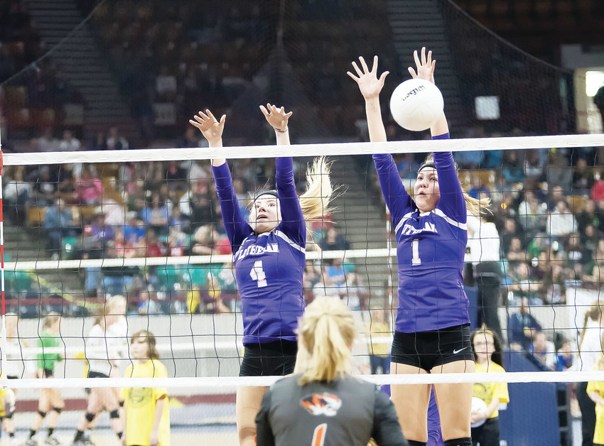 Lutheran's Cora Rice, left, and Mary Dyson block a shot from Sterling's Kyndall Feather.