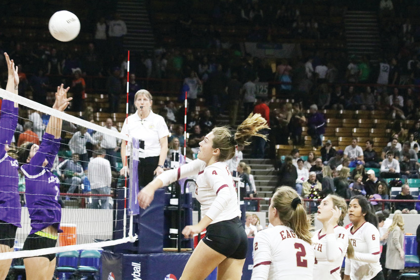Bella Keister's hit for Faith Christian carries the ball over the blockers in the Nov. 11 semifinal match against Lutheran at the Class 3A state volleyball championship tournament played at the Denver Coliseum. Keister recorded a kill on this hit which added to her team high total of 198 for the season. The Eagles tested Lutheran but the Lions won the semifinal match, 3-0.