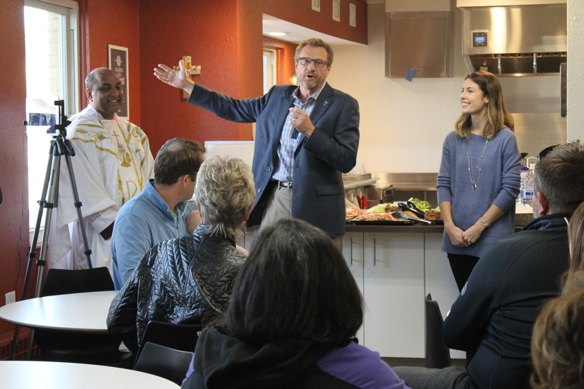 Larry Smith, CEO of Catholic Charities, speaks at an open house at Lakewood's Marisol Homes location on Nov. 9.