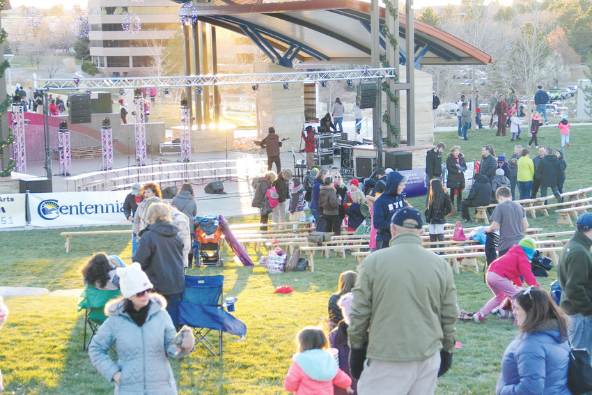 Attendees of the annual Centennial Holiday Celebration Nov. 18. Holiday lights wrapped around trees and suspended at the amphitheater ushered in the holiday spirit at Centennial Center Park. Photo by Ellis Arnold