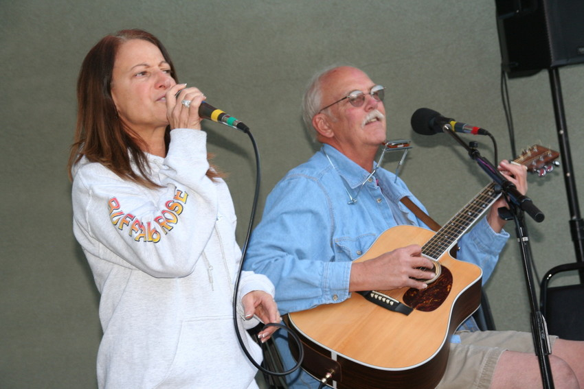 Nancy Jurbala, a solo vocalist of Golden, performs with Bill George, a multi-instrumentalist of Littleton on the patio at the Buffalo Rose on Nov. 13. George has been performing at the venue for 15 years, and hopes to come back one it reopens next year.