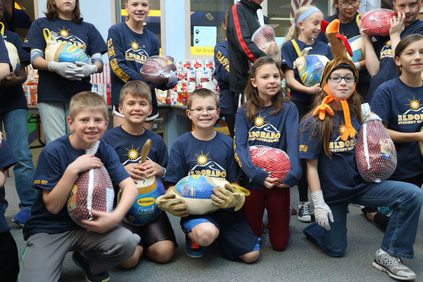 Students in government at Eldorado Elementary School in Highlands Ranch proudly show off the turkeys they collected for the school's 12th annual Turkey Drive. The birds, along with canned goods, were sent to Denver Rescue Mission on Nov. 16.