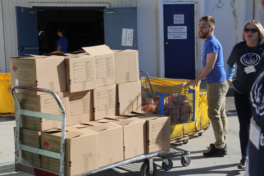 Boxes to be loaded up and delivered to seniors in need in the Denver metro area at Integrated Family Community Services Nov. 15. Allstate insurance agents and other volunteers helped package and deliver the Thanksgiving foods.