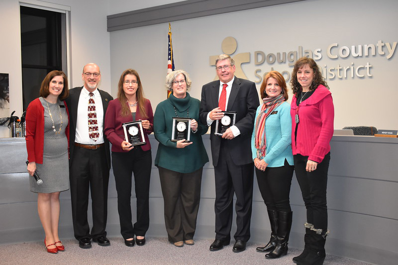 Interim Superintendent Erin Kane, left, David Ray, Meghann Silverthorn, Judi Reynolds, Jim Geddes, Anne-Marie Lemieux and Wendy Vogel pose for a final photo as a school board at a board of education meeting in Castle Rock on Nov 28. Former board member Steven Peck was absent from the meeting.