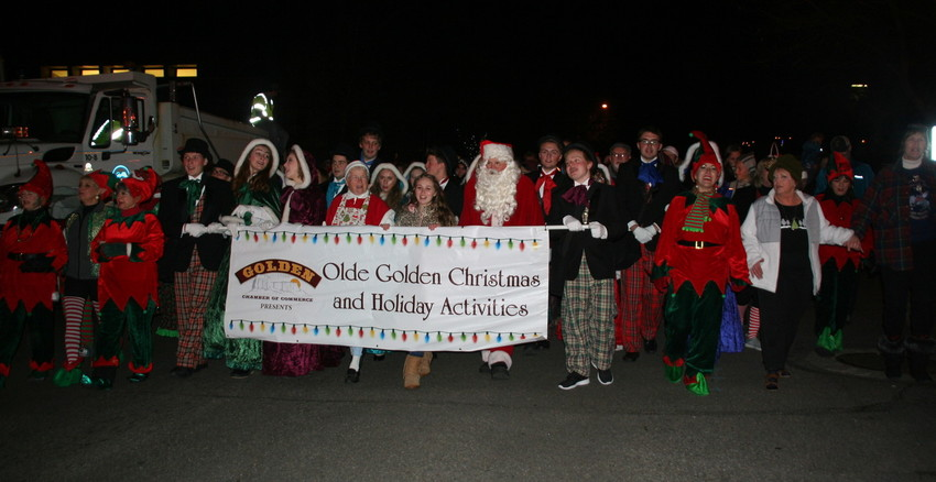 Event organizers, Santa, carolers and elves lead the way down Washington Avenue in Downtown Golden for the 30th annual Candlelight Walk on Dec. 1.