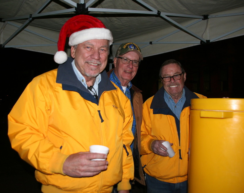 Golden Lions Club members, from left, Ken Park, Bill Eckhardt and Ed Dorsey get their picture taken in the midst of serving hot cider to the thousands of people who attended the 30th annual Candlelight Walk on Dec. 1 on Washington Avenue in Downtown Golden.