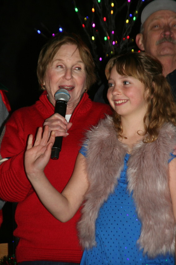Golden Mayor Marjorie Sloan introduces Golden resident Ruby Frank, 10, as the winner of the second annual Light the Lights contest. As the winner, Frank got to light up downtown Golden's holiday lights during the Light the Lights presentation following the Candlelight Walk on Dec. 1.
