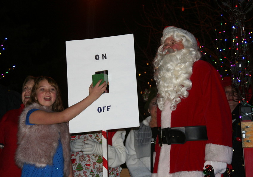 Ruby Frank, 10, of Golden, Santa and other holiday characters, Golden Mayor Marjorie Sloan and other city officials, and representatives with the Golden Chamber of Commerce, wait for the countdown to Light the Lights on Dec. 1 — a presentation that followed the 30th annual Candlelight Walk.