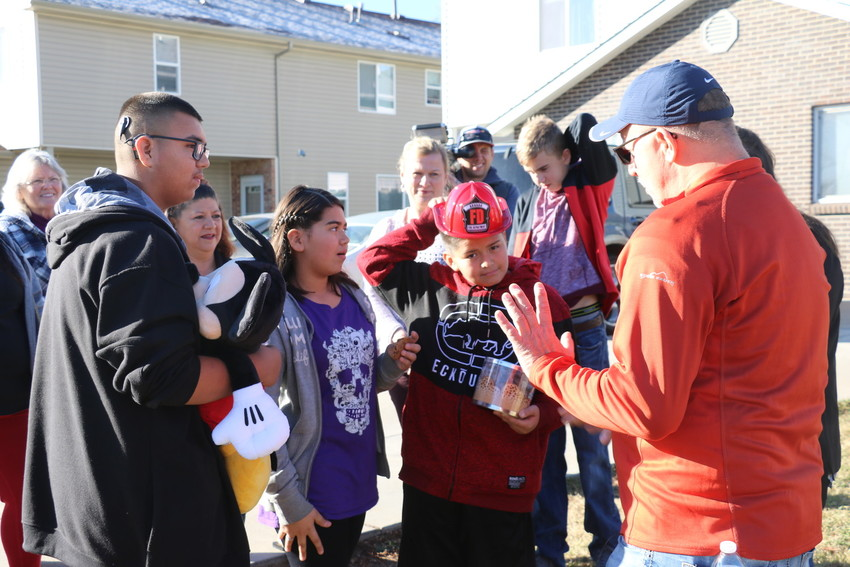 The Balderas-Soto family speaks with Frank Squeo, founder of Baking Memories 4 Kids, outside of their home on the morning of Nov. 30. Thanks to Baking Memories, the family will be going on a weeklong trip to amusement parks in Florida in March.