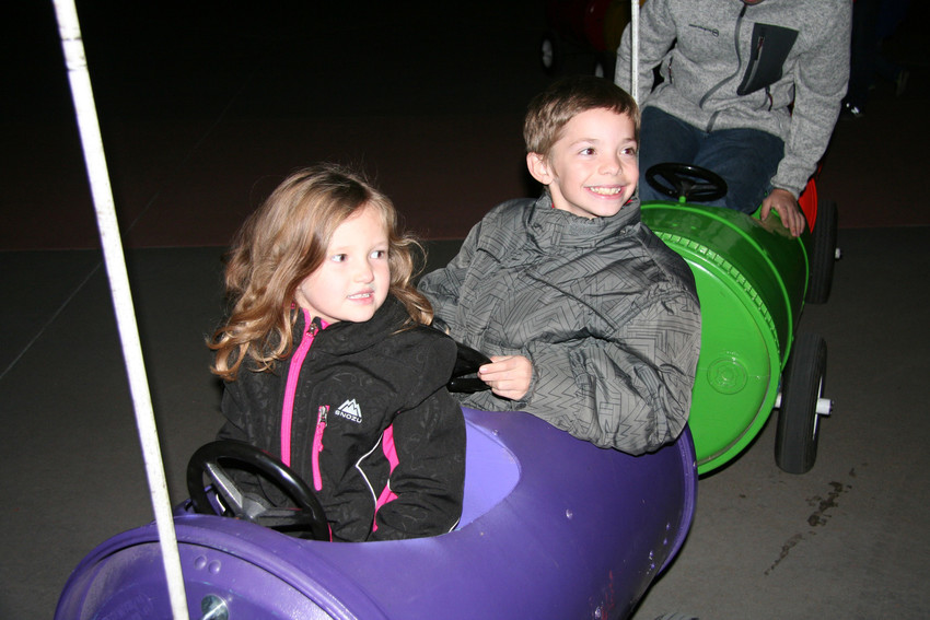 Cousins Aubrey and Jordan from Wheat Ridge hop in the kiddie train that circulated during the Wheat Ridge 2017 Holiday Celebration and tree lighting, and pose for a photo for Jordan's mom Jacquelyn Einspahr.