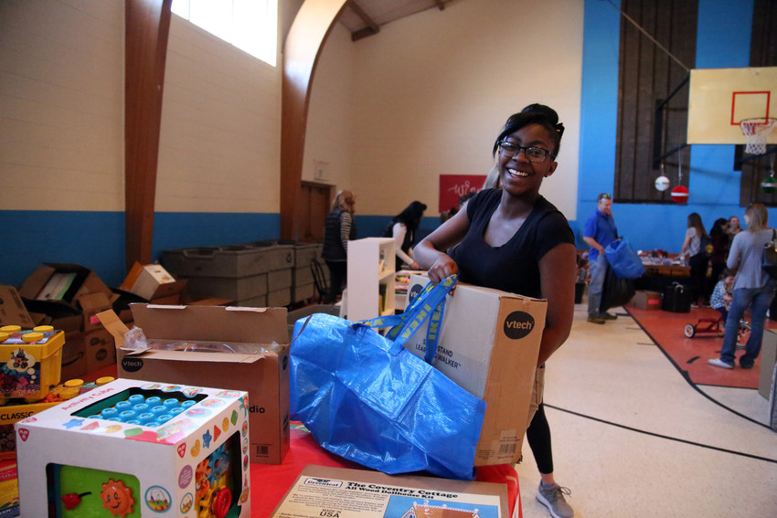 Trinity Williams, 18, was excited to find her son a walker for Christmas at the Hope House Santa Shop Dec. 9.