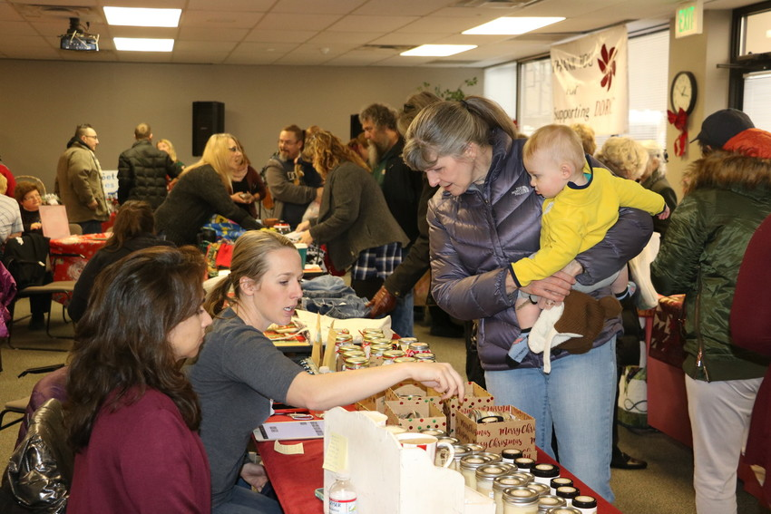 Shoppers examine the wares at the 16th annual Developmental Disabilities Resource Center holiday market on Dec. 7. The annual public event gives shoppers the chance to buy gifts and treats made by clients of the center.