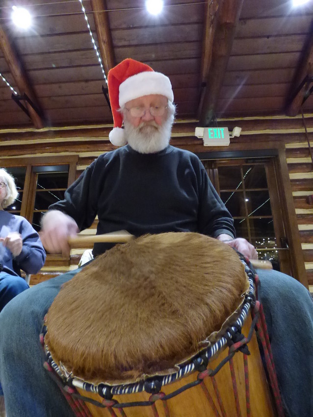 "Jim Parent, who calls himself a lifelong drummer, pounds on a djun-djun drum. ""I was one of those kids who was always beating on my desk at school,"" Parent said. ""I never think of this in terms of some higher level - I just like the rhythm."""