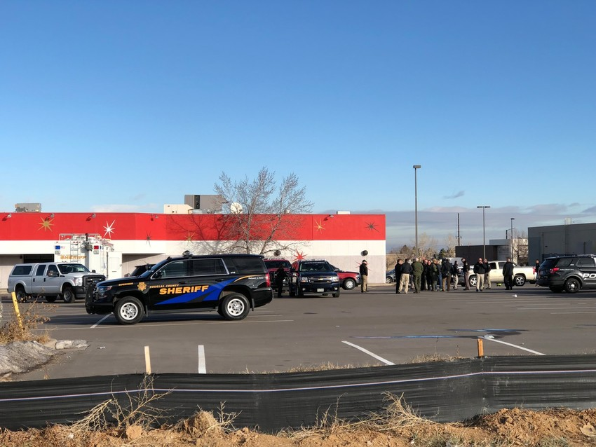 Authorities gathered in the parking lot of a nearby business in Highlands Ranch the morning of Dec. 31 as the investigation into the shooting of multiple deputies continued.