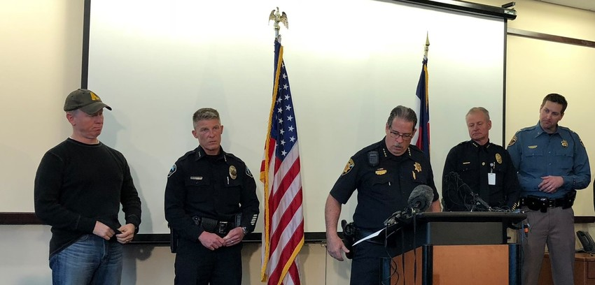 Douglas County Sheriff Tony Spurlock, center, flanked by members of area law enforcement agencies, addresses the media after the Dec. 31 fatal shooting of a deputy.