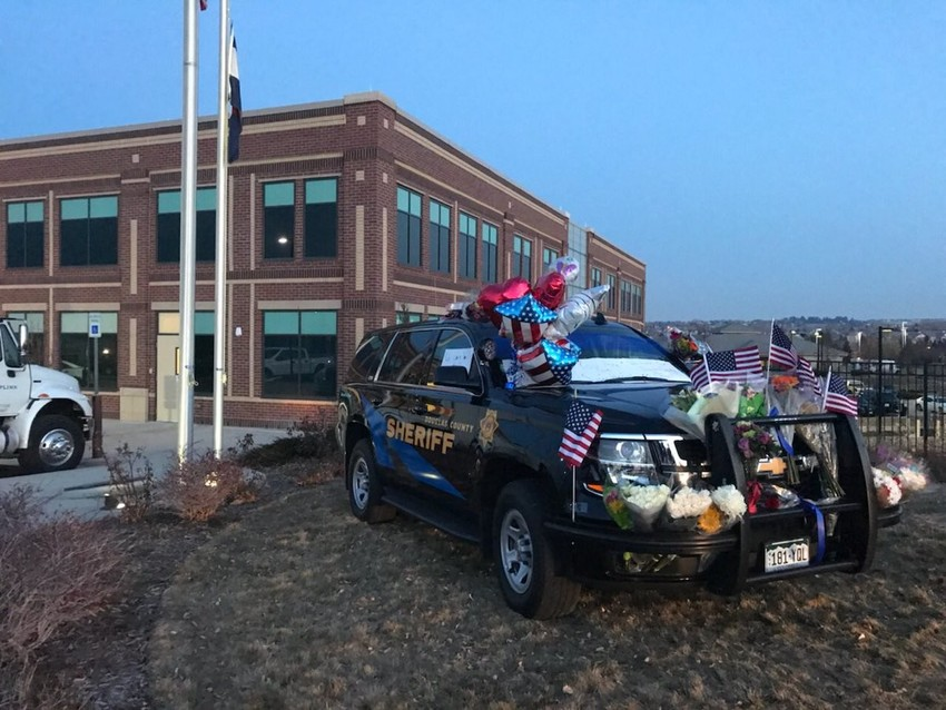 The memorial at the county substation showing community support.