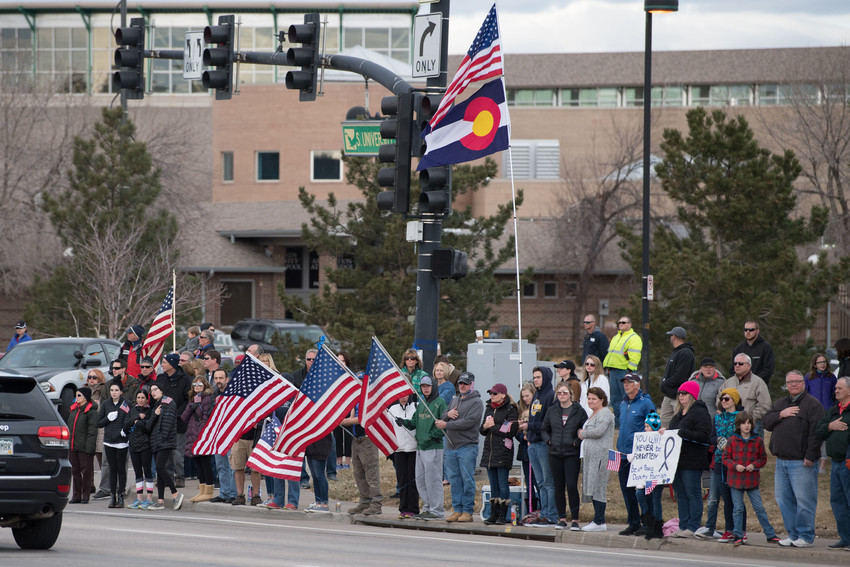 Hundreds of mourners lined the corner of University Boulevard in front of the Eastridge Recreation Center in Highlands Ranch for the funeral procession of slain Deputy Zackari Parrish. Photo by Paul DiSalvo