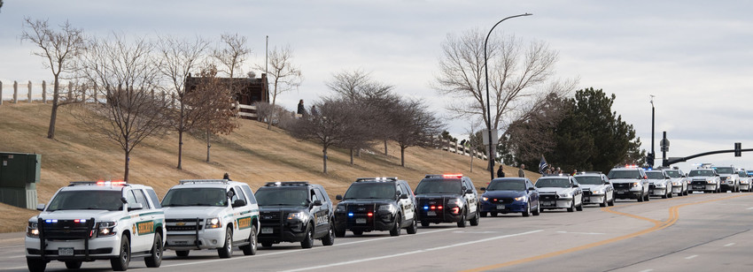 Police and other first responder vehicles stretched for miles in the funeral procession of Deputy Zackari Parrish.  Photo by Paul DiSalvo