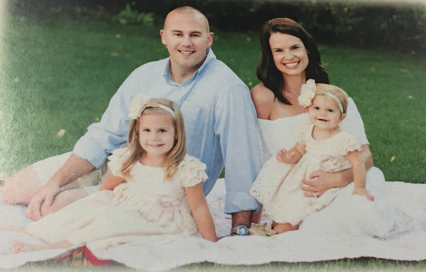 An image taken from the program of the funeral service for Douglas County Deputy Zackari Parrish, who was killed in the line of duty on Jan. 5. Shown are Parrish, his wife Gracie and their two daughters.