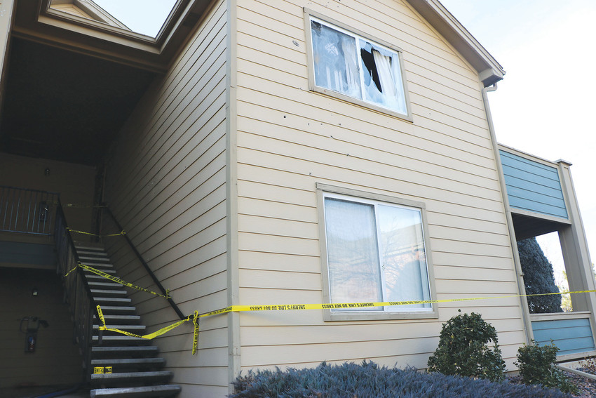 Caution tape blocks the entrance Jan. 1 to the apartment building in Highlands Ranch where the man who shot five law enforcement officers and two civilians lived. The suspect, Matthew Riehl, was shot and killed after a nearly two-hour standoff at Copper Canyon Apartments. Photo by Alex DeWind