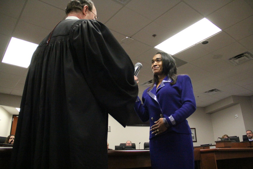 District 4 Councilmember Marlo Alston, who won an election race with a razor-thin margin that endured a recount, gets sworn in by Municipal Judge Ford Wheatley at the Jan. 8 council meeting. New councilmembers Mike Sutherland and Tammy Maurer also were sworn in, and Kathy Turley was sworn in for another term.