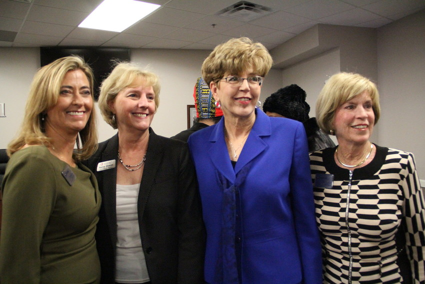 From left, Mayor Stephanie Piko, Arapahoe County Commissioner Nancy Sharpe, former Mayor Cathy Noon and Councilmember Kathy Turley pose for photos at the Jan. 8 council meeting. Sharpe represents an area that includes Centennial for the county government.