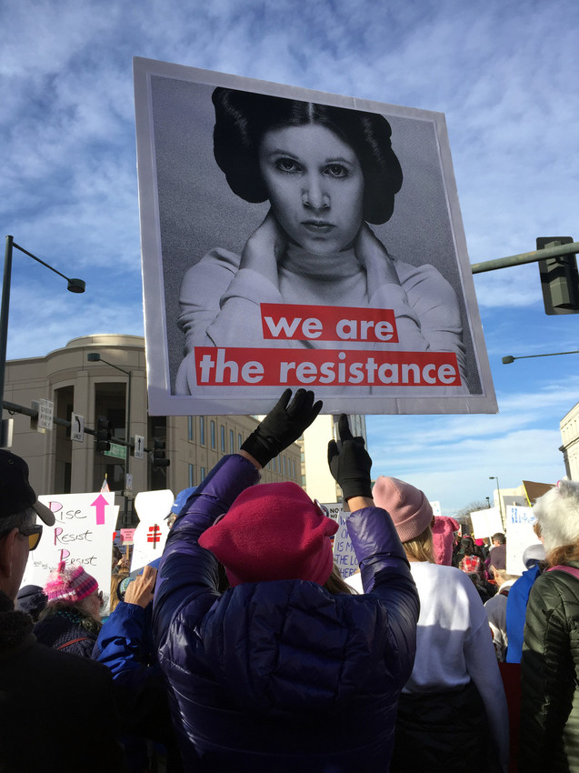 Mary Joe Kohlruss, of Arvada, hoists her sign high at the 2018 Women's March in Denver Jan. 20.