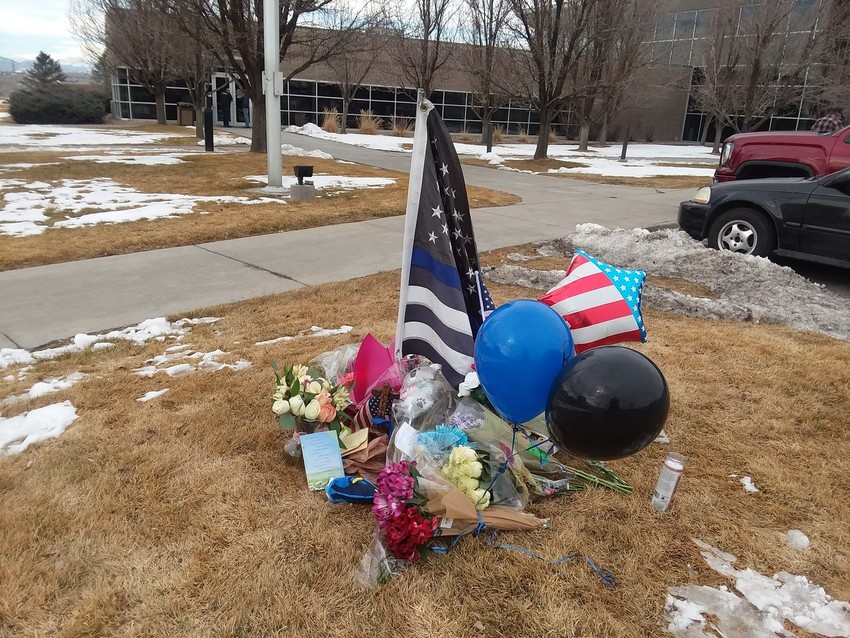 Adams County residents and mourners have begun a makeshift memorial for Deputy Heath Gumm Jan. 25. According to the Sheriff's department, Gumm was killed Wednesday night.