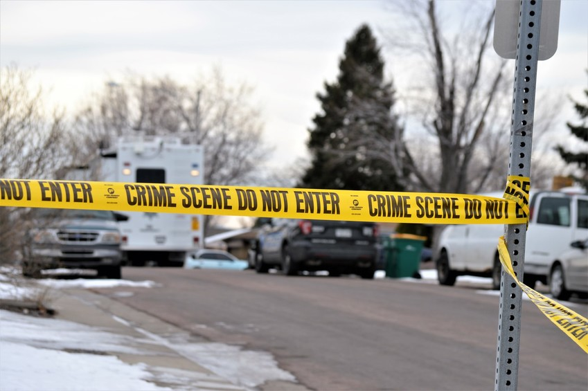 Crime scene tape closes the intersection of Edison St. and 88th Avenue in unincorporated Adams County Jan. 25. Sheriff's deputies are investigation the shooting of one of their own in the neighborhood and closed off the streets between Dawson east to Edison and 88th Avenue south to Sheldon Drive while they continued searching for two suspects.