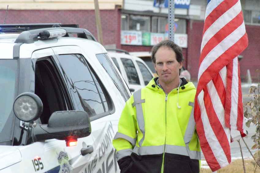 Thornton resident Michael Kapaun brought his American flag to the site of an alleged Jan. 24 shooting to honor local police. Adams County Deputy Sheriff Heath Gumm died in the shooting, and Kapaun said he wanted to honor all first responders