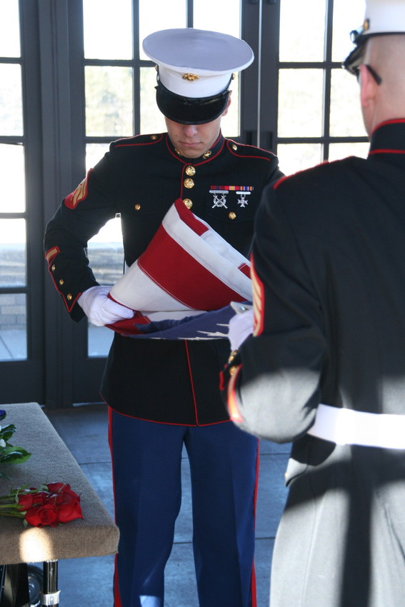 The folding of the flag before it is presented to the family at the military service for Marine Sgt. Max Brown of Arvada, the afternoon of Jan. 11