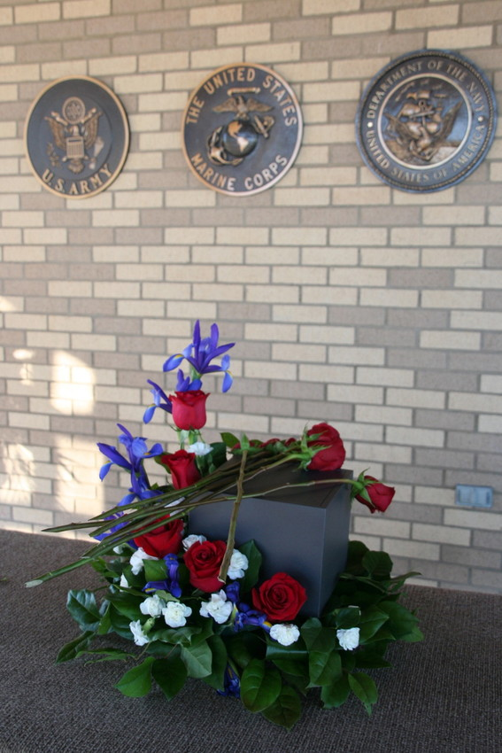 Roses placed atop the ashes at the military service for Marine Sgt. Max Brown of Arvada, the afternoon of Jan. 11