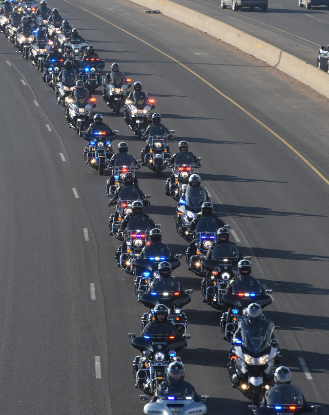Various Colorado motorcycle police lead the formal funeral procession along northbound I-25, for slain Adams County Sheriff's Deputy Heath Gumm on Friday, February 2, 2018.