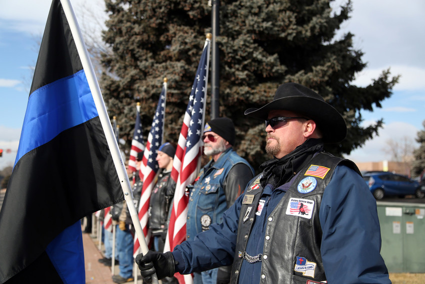 Castle Pines resident Don Martin stands alongside the Patriot Guard Riders to honor Deputy Heath Gumm Feb. 2.