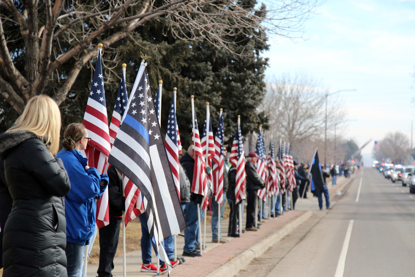 The streets near Flatirons Community Church in Lafayette were lined with community members who came to pay tribute to fallen Deputy Heath Gumm.