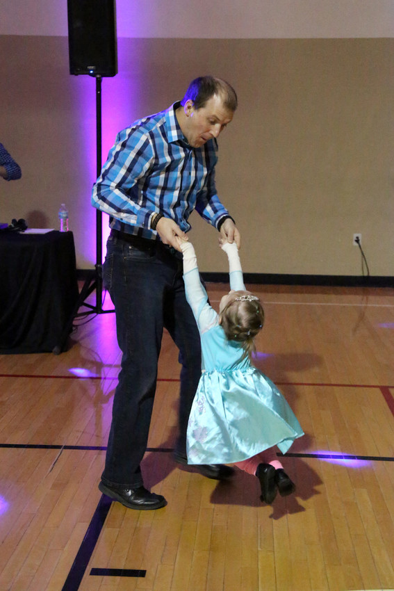 Sixty-six dads dressed up for a night with their daughters at the Arvada YMCA's Father, Daughter Princess Ball.