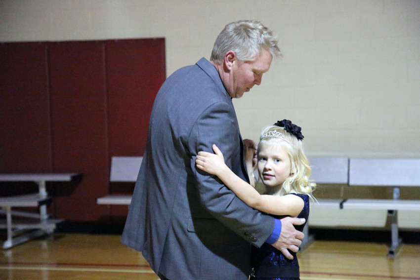 Taylor Nickel dances with her dad, Brian, at their first father, daughter dance Feb. 9.