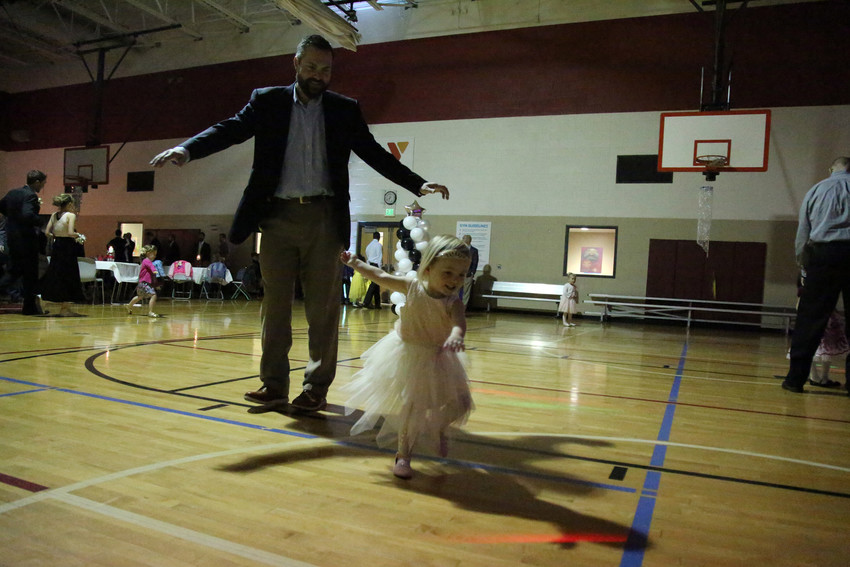 Johri Litman twirls around the dance floor with his daughter, Bexley, at the Father, Daugther Princess Ball.