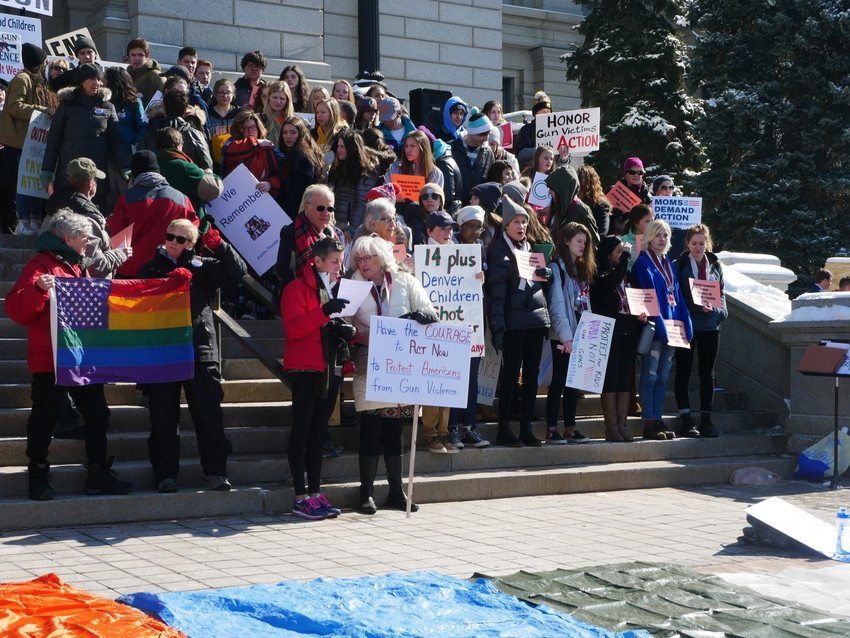 Students from Littleton Public Schools joined other groups to protest school violence on Feb. 21, with organizers focusing on a comprehensive approach incorporating mental health care, cultural change and gun law reform.